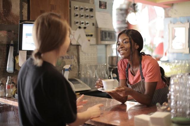 Barista and customer at Cafe